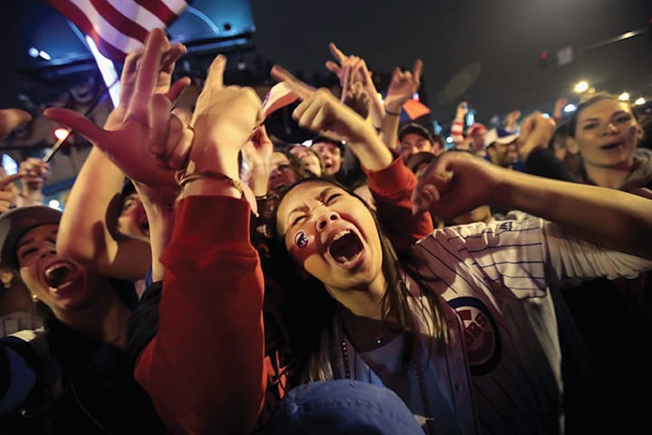 CHICAGO, IL - NOVEMBER 02: Chicago Cubs fans celebrate outside Wrigley Field as the Cubs play the Cleveland Indians during game seven of the 2016 World Series on November 2, 2016 in Chicago, Illinois. The Cubs defeated the Indians 8-7 to win their first World Series title since 1908. (Photo by Scott Olson/Getty Images)